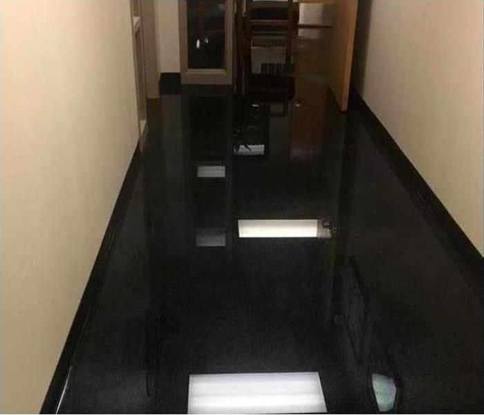 hallway flooded with water inches deep