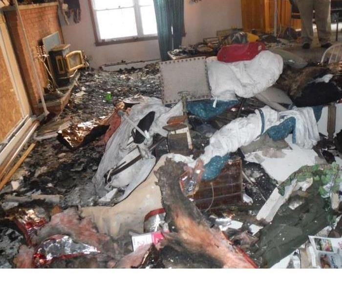 Fire ravaged contents and debris in a living room