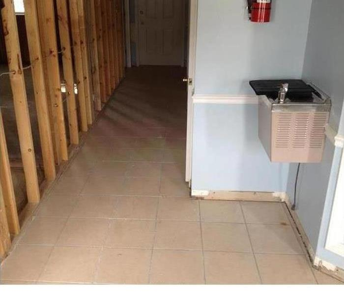 clean hallway with walls removed