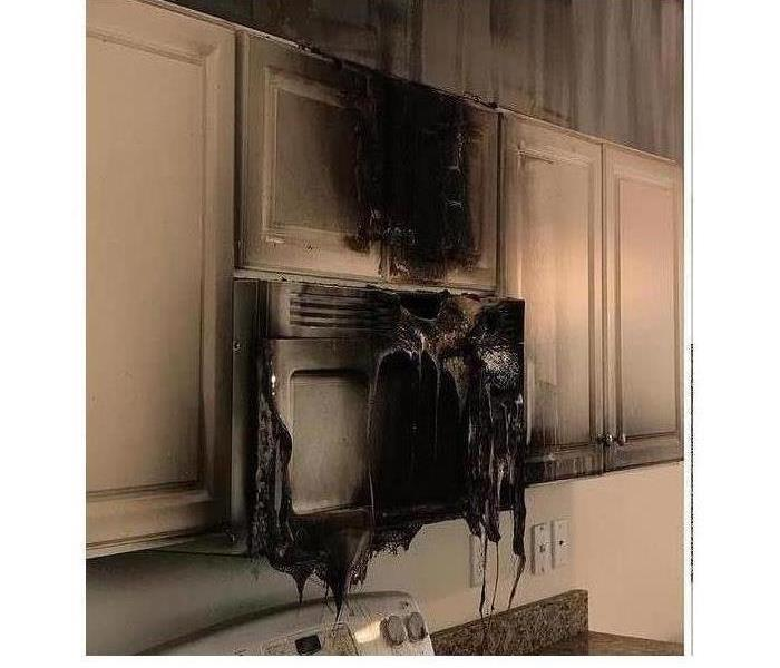 melted microwave and smoke damaged kitchen cabinets