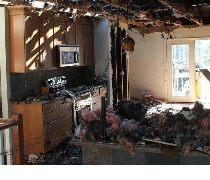 fire raveged kitchen with heavy smoke damage