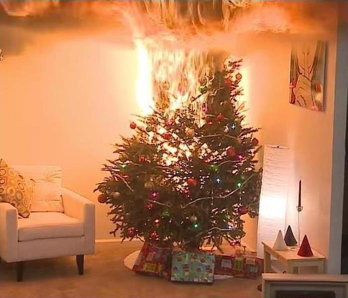 A decorated Christmas tree in fire