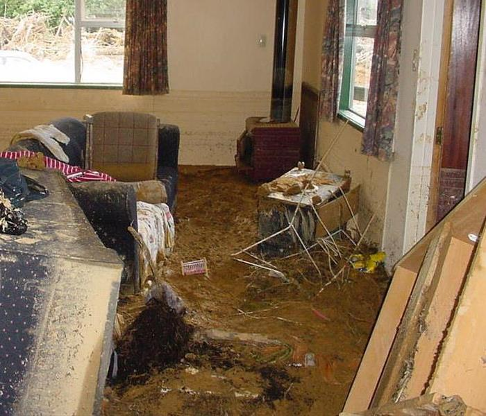 mud filled home after a flood