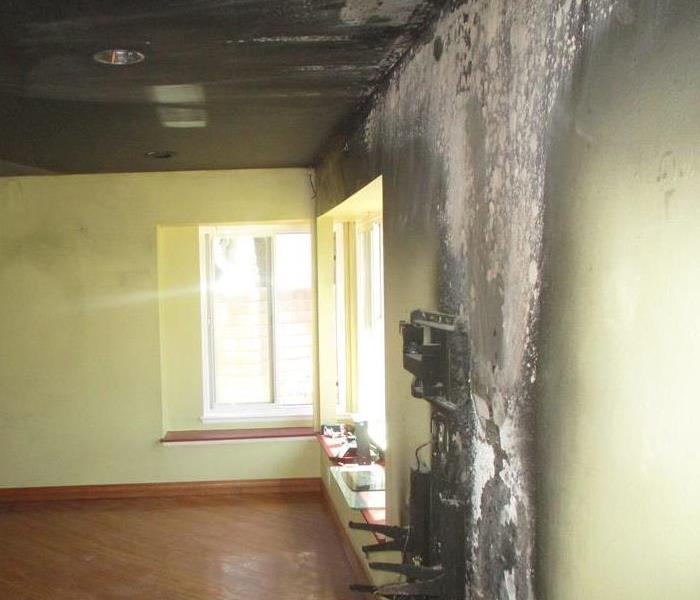 fire and smoke damaged walls in a home