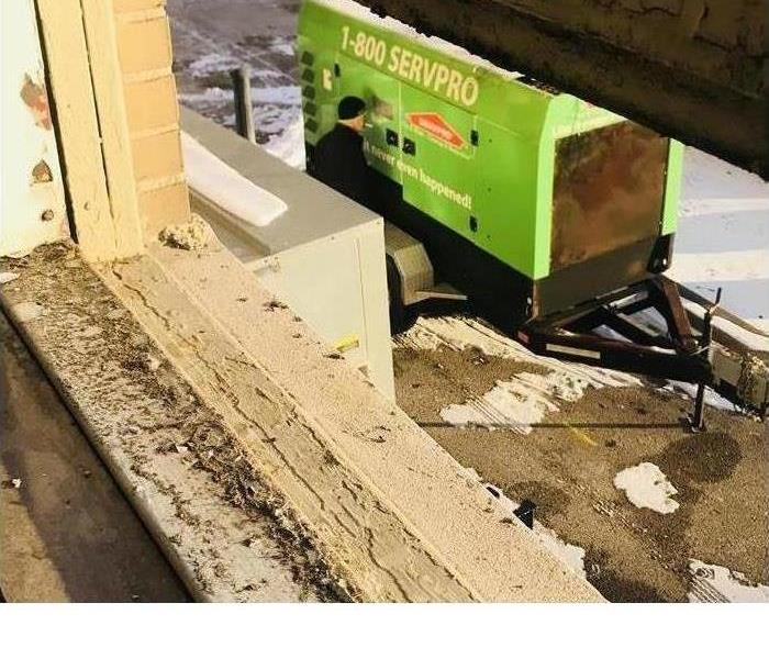 SERVPRO equipment outside a storm damaged window